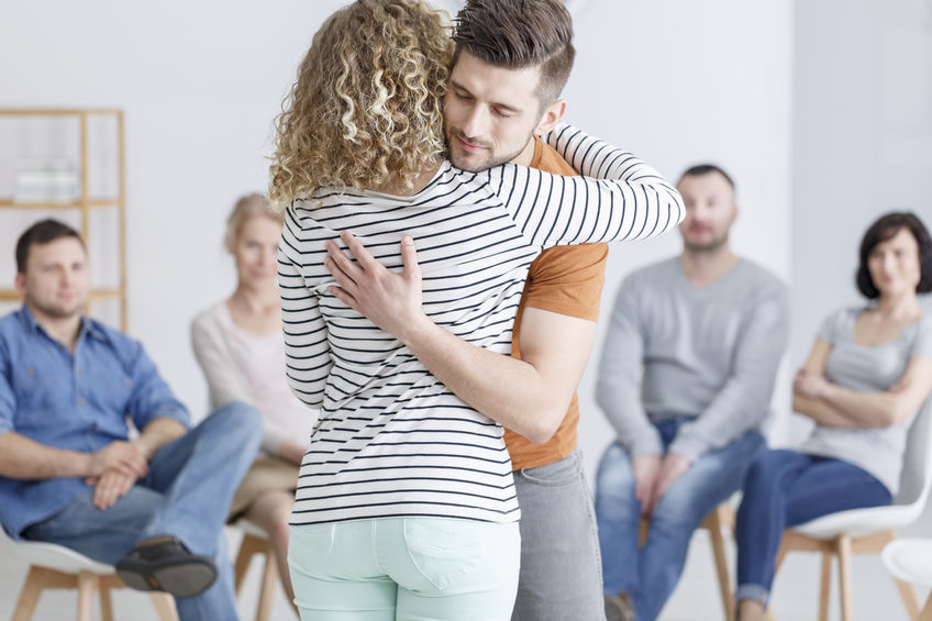 couple hugging during christian marriage counseling process